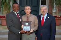Mark Steffen (center) of Winning Solutions, Inc. is pictured accepting a plaque recognizing WSIs service to the Iowa Sports Foundation from Former Governor Terry Branstad (right). Jim Halihan Executive Director of the Iowa Sports Foundation (left) Former Iowa Governor Robert Ray, among others was in attendance.